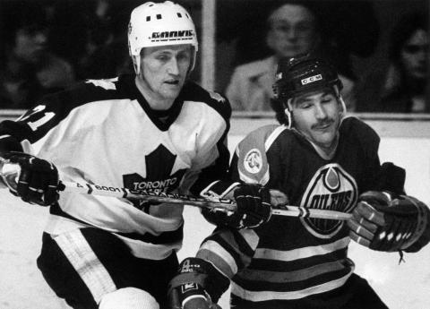 two men playing hockey
