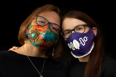 Shelby Lisk and her mother wearing hand-beaded masks