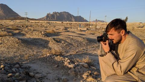 Graeme Smith photographs a graveyard in Afghanistan