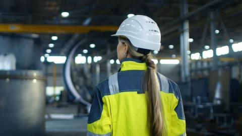 woman in a hard hat on a factory floor