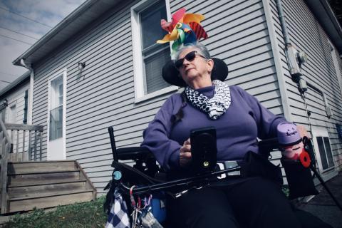 a woman using a wheelchair