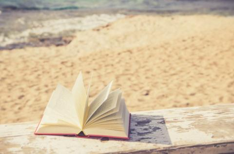 a book on a beach