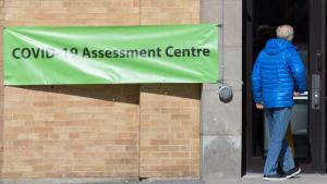 a man walks into a COVID-19 assessment centre from the article How do COVID-19 assessment centres work? TVO.org explains
