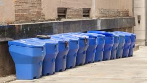 a row of blue bins from the article Ontario's blue-bin program is in serious trouble