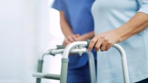 a woman using a walker from the article Volunteers step up to help out in long-term care