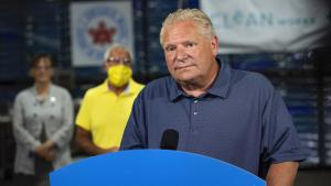 Doug Ford stands behind a podium from the article Parents don't expect miracles from their government. They expect effort