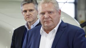 a closeup of two men wearing suits from the article Next year is going to be expensive for Ontario — whether Doug Ford likes it or not
