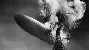 black and white photo of a blimp crashing into a tower from the article We'll never learn from this disaster unless we keep it in perspective