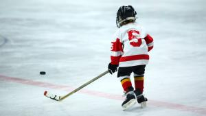 young hockey player from the back from the article As conditions improve, people — and institutions — struggle to lower their guard