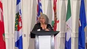 woman at podium from the article How government inaction on MMIWG could harm Indigenous women
