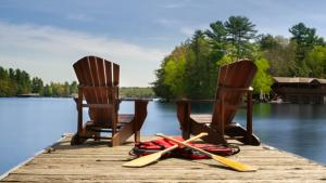 two Adirondack chairs from the article Why you should think twice before heading to the cottage