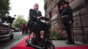 man in a power wheelchair on a red carpet from the article 'Catastrophic Pandora's box': Disabled Ontarians speak out against proposed MAID law
