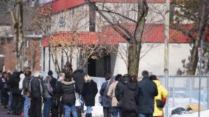 dozens of people in a lineup from the article COVID-19 testing in Ottawa is a disaster for vulnerable residents