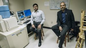 two men sit in a lab from the article Why these Hamilton researchers are melting down masks