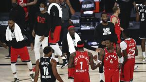 two basketball teams on the court after a game from the article What the live arts can learn from the NBA bubble