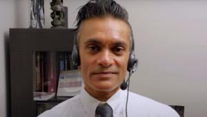 man wearing a headset and a tie from the article 'People have stopped caring': Epidemiologist Raywat Deonandan on COVID-19 in 2021