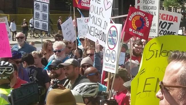 people holding placards at a protest