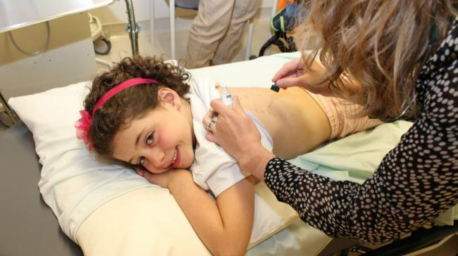 a child being examined at a hospital