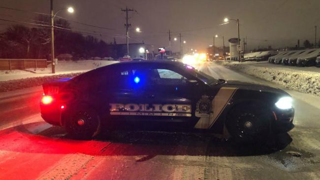Timmins police car on a winter road