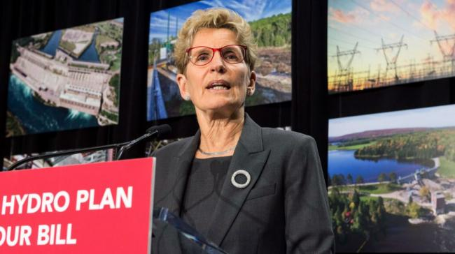 Kathleen Wynne speaks from a podium about hydro