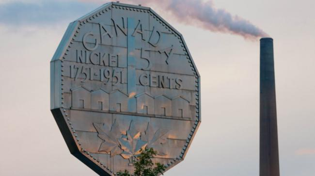 a large nickel on top of a building in Sudbury