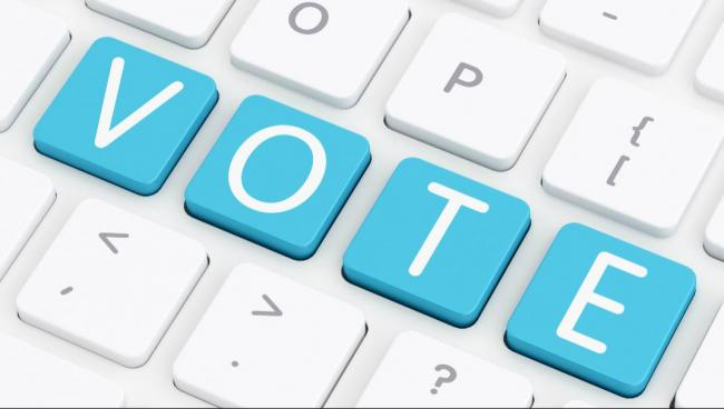 """the word """"vote"""" spelled out on a computer keyboard"""