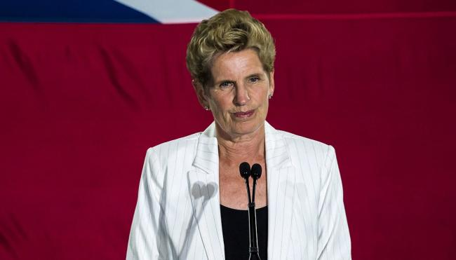 Kathleen Wynne speaks from the podium on election night, June 7, 2018