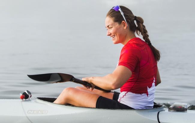 Woman sitting in kayak