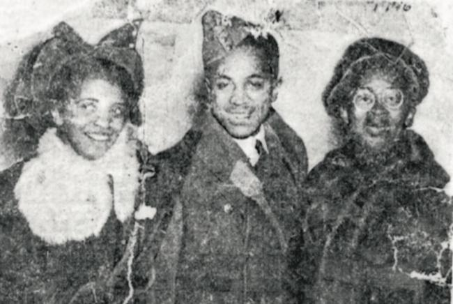 three people smiling in an old photograph