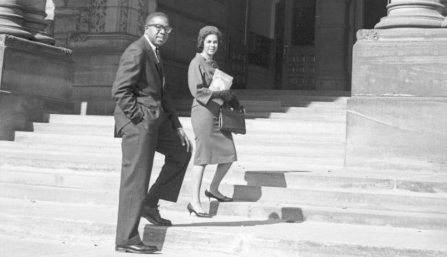 a man and a woman walking up stairs