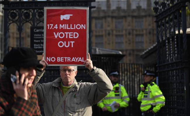 A pro Leave EU campaigner holds up a sign