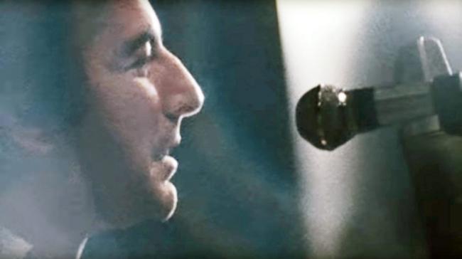 musician Leonard Cohen at a microphone