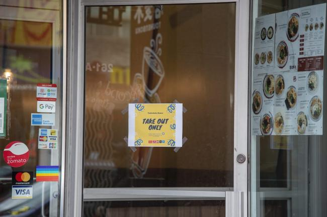take-out only sign on restaurant door