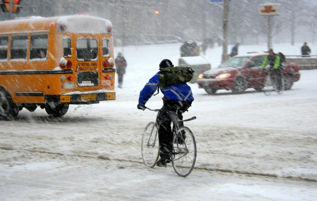a cyclist on a snowy street