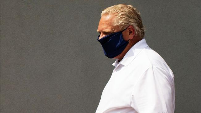 Man walking wearing mask.