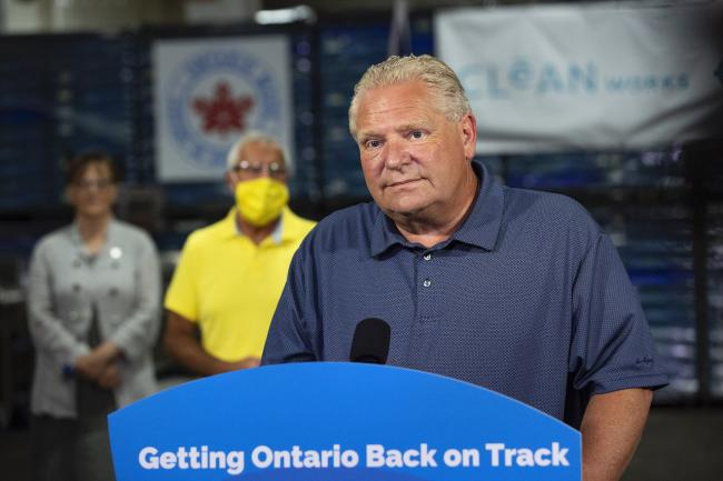 Doug Ford stands behind a podium