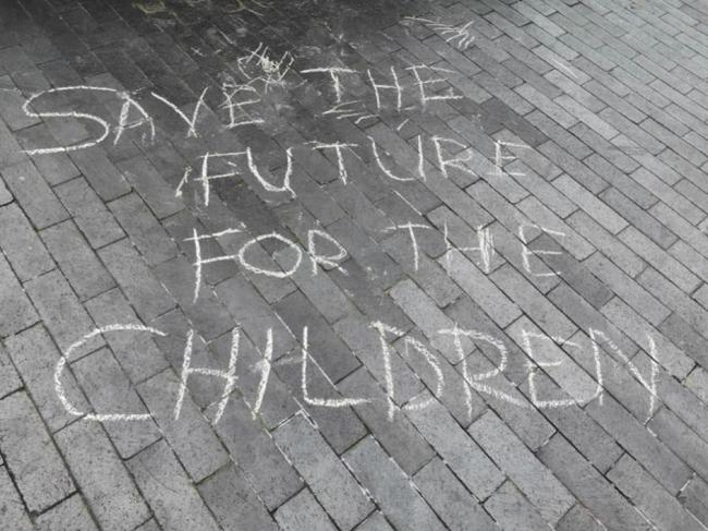 """chalk on sidewalk that says, """"Save the Future for the Children"""""""