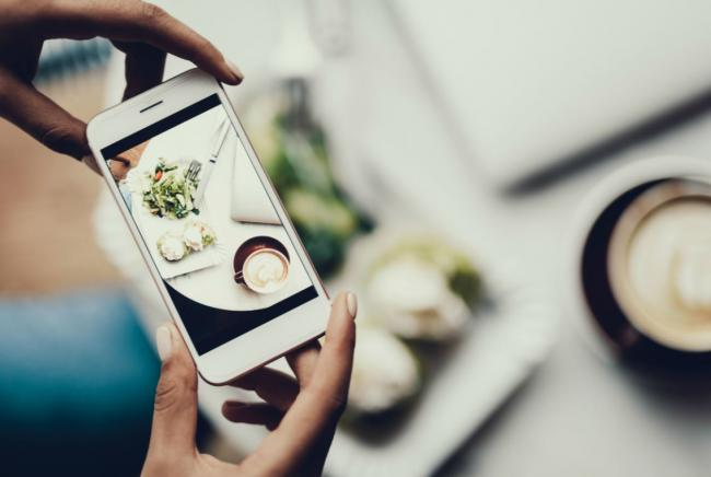 a person taking a photo of their dinner