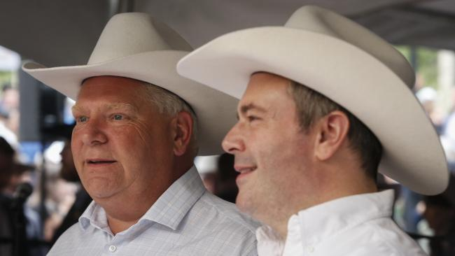 close-up of two men wearing cowboy hats