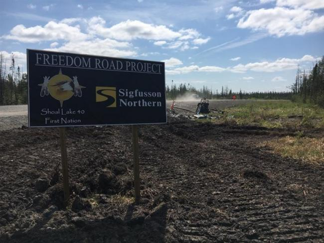 Road sign that says: Freedom Road Project