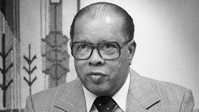 man wearing glasses and suit