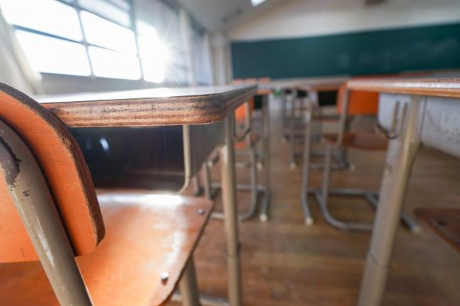 Empty classroom with desks.