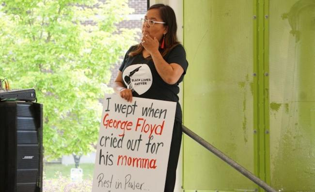 a woman holding a placard