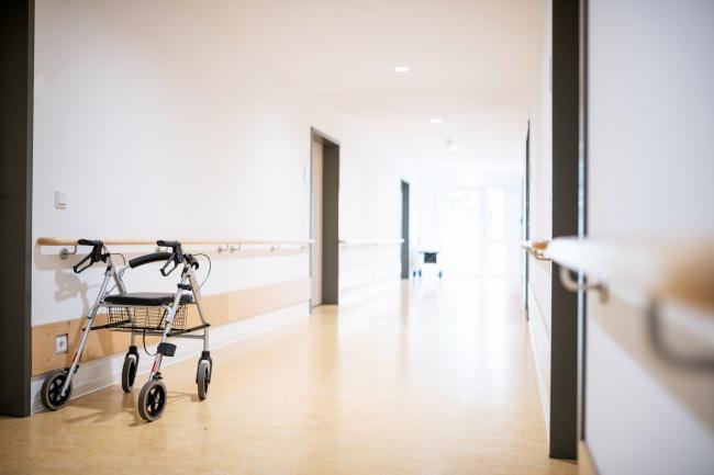 a walker in an empty hallway