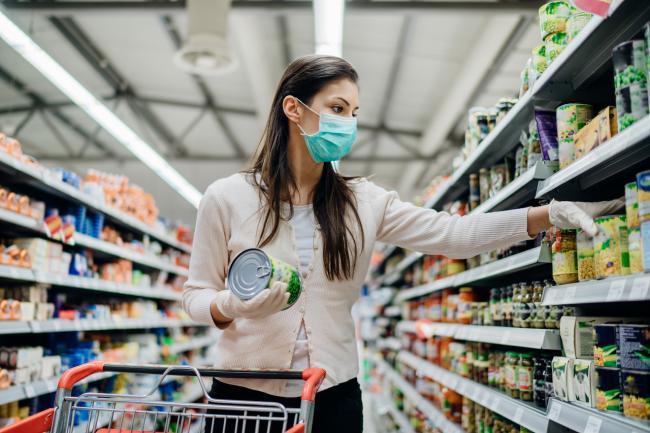 woman in mask shopping for groceries