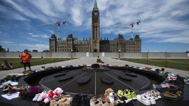 shoes arrange in a circle in front of Parliament Hill