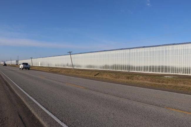 a stretch of highway by a greenhouse
