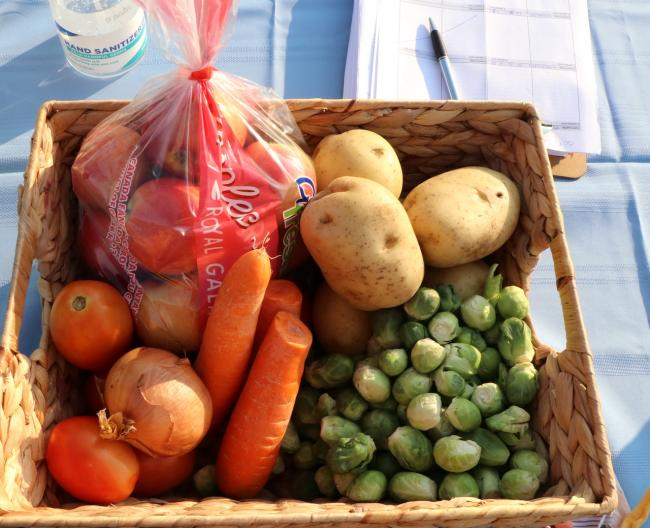 a box of fresh fruit and vegetables