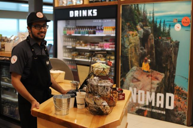 Man standing at counter in store