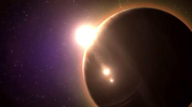 Artist's concept of a distant planet and star.